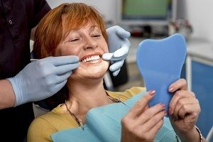 Woman Smiling During Dental Exam